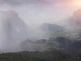 veils of rain over forest landscape. © Dudarev Mikhail/fotolia.com