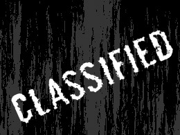 the word Classified in front of rough blackened background