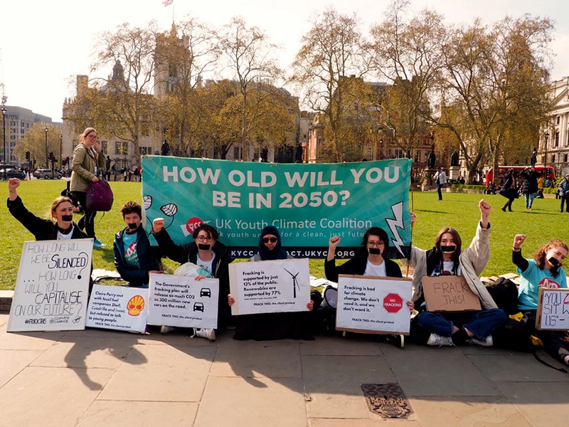 UKYCC demo with banner How old-will you be in 2050? @ UKYCC